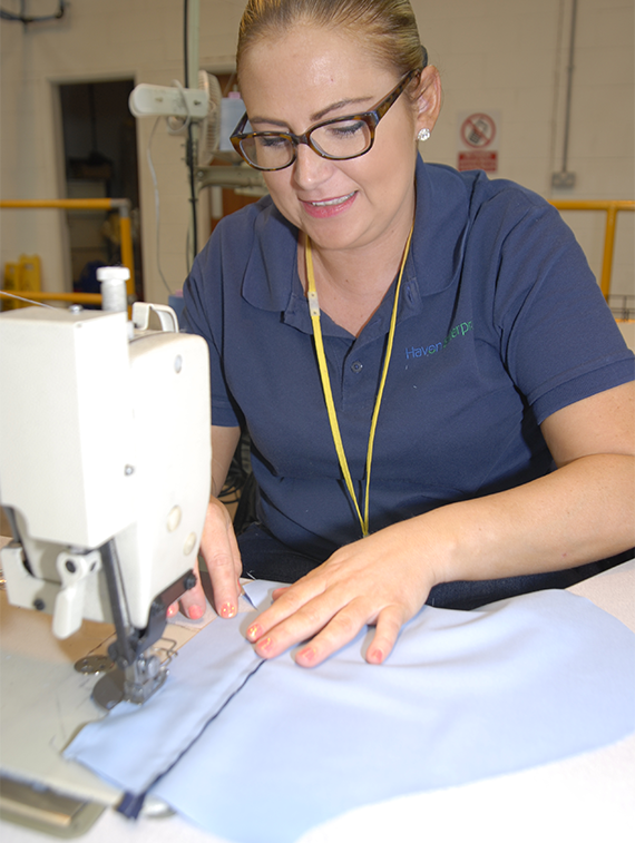 Nicola using a sewing machine at Haven PTS